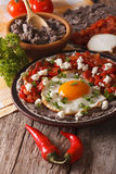 Mexican breakfast: huevos rancheros close-up. vertical Stock Photography