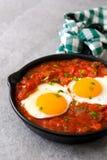 Mexican breakfast: Huevos rancheros in iron frying pan Stock Image
