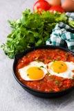 Mexican breakfast: Huevos rancheros in iron frying pan Stock Photography