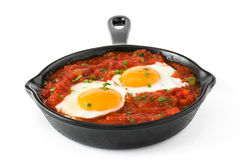 Mexican breakfast: Huevos rancheros in iron frying pan Royalty Free Stock Images