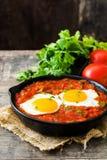 Mexican breakfast: Huevos rancheros in iron frying pan Royalty Free Stock Image