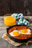 Mexican breakfast: Huevos rancheros in iron frying pan Stock Images
