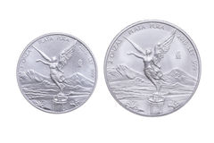 Mexican bullion silver coin comparison. Side by side size comparison between one ounce and two ounce Mexican silver bullion libertad coins  on white background Stock Image