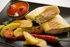 Mexican burrito served with potato, tomato and chilli Stock Image