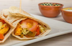 Mexican burritos filled with chicken, peppers, rice and tomato Stock Images