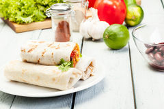 Mexican burritos on a plate Royalty Free Stock Photo