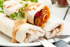 Mexican burritos on a plate Royalty Free Stock Images