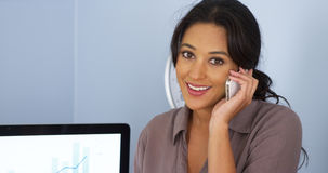 Mexican business woman talking on cellphone and smiling Royalty Free Stock Images