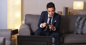 Mexican businessman playing video games at home Royalty Free Stock Photo
