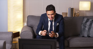 Mexican businessman playing video games. Businessman playing video games at home Stock Photography