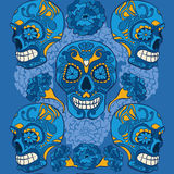 Mexican calaveras with merigold ornamens. Mexican skulls surrounded by merigolds Royalty Free Stock Images