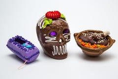 Mexican Calaverita de azucar , and Mole con Pollo and Coffin candy Royalty Free Stock Photos