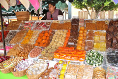 Mexican Candies. Market stall with a variety of mexican candies covered with plastic to put off the flies Royalty Free Stock Photos