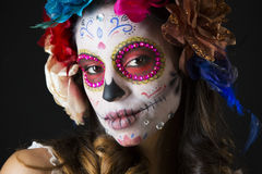 Mexican candy scull. Beautiful woman with custom designed candy skull mexican day of the dead face make up Stock Photo
