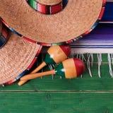 Mexican carnival sombrero and maracas fiesta scene top view. Mexico carnival sombrero and maracas stock photography
