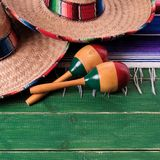 Mexican carnival sombrero and maracas square format. Mexico carnival sombrero and maracas royalty free stock photography