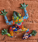 Mexican ceramic frog. Frog - toad ceramic decoration on a pink wall Stock Photos