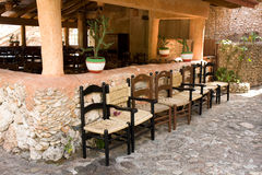 Mexican chairs. Row of the chairs outside of the traditional mexican restaurant Stock Image