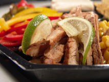 Mexican chicken. Closeup with limeslices, corns, paprika, and jalapeno stock photography