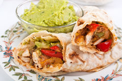 Mexican chicken and beef fajitas. Traditional mexican chicken and beef fajitas with guacamole Stock Photography