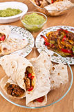Mexican chicken and beef fajitas. Traditional mexican chicken and beef fajitas with guacamole Stock Photos