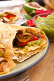Mexican chicken and beef fajitas. Traditional mexican chicken and beef fajitas with guacamole Royalty Free Stock Images