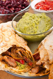 Mexican chicken and beef fajitas. Traditional mexican chicken and beef fajitas with guacamole Royalty Free Stock Image