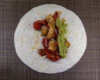 Mexican chicken fajita with guacamole and peppers stock images
