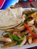 Mexican chicken fajitas. Mexican hot chicken fajitas, in a mexican restaurant Stock Images