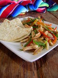 Mexican chicken fajitas. Mexican hot chicken fajitas, in a mexican restaurant Stock Photography