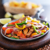 Mexican chicken fajitas. In iron skillet with peppers Stock Photo