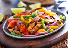 Mexican chicken fajitas. In iron skillet with peppers Stock Images