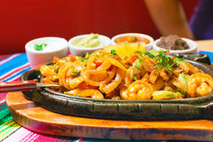 Mexican chicken fajitas with sauces. On the table Stock Photography