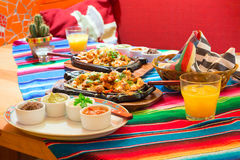 Mexican chicken fajitas with sauces. On the table Royalty Free Stock Photos