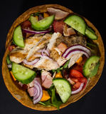 Mexican Chicken Salad In Tortilla Bowls. Served with hot souce stock photos
