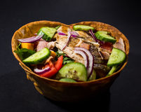 Mexican Chicken Salad In Tortilla Bowls. Served with hot souce royalty free stock images