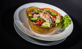 Mexican Chicken Salad In Tortilla Bowls. Served with hot souce royalty free stock photo