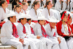 Mexican children. ISTANBUL - APRIL 23: Mexican children in white costumes wait their turn at National Sovereignty and Children Day festival on April 23, 2010 in Stock Photo