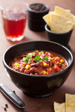 Mexican chili con carne in black bowl Stock Photo