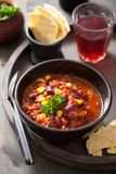 Mexican chili con carne in black bowl with tortilla Royalty Free Stock Photos
