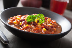 Mexican chili con carne in black plate Royalty Free Stock Photography