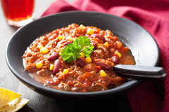 Mexican chili con carne in black plate Stock Photos