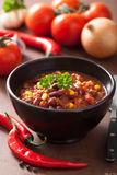 Mexican chili con carne in black plate with ingredients Royalty Free Stock Image