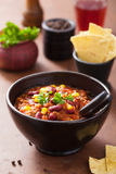 Mexican chili con carne in black plate with ingredients Stock Photo