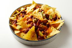 Mexican chili con carne with nachos and cheese stock photo