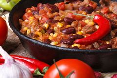 Mexican chili con carne in a pan on a wooden background Royalty Free Stock Photo