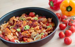 Mexican chilly beans in tomato sauce. Mexican chilly beans in spicy sauce with tomatoes, leek and peppers Royalty Free Stock Photo