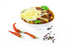 Mexican chilly con carne with meat and black beans. In a white bowl royalty free stock photo