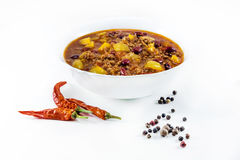 Mexican chilly con carne with meat and black beans. In a white bowl royalty free stock images