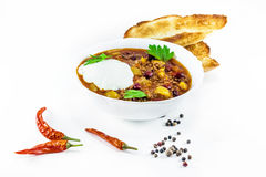 Mexican chilly con carne with meat and black beans. In a white bowl stock image